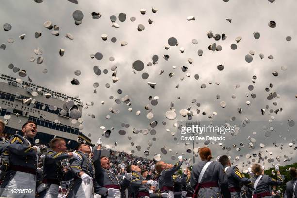 West Point graduates toss their hats in the air at the conclusion of the U.S. Military Academy Class of 2019 graduation ceremony at Michie Stadium on...