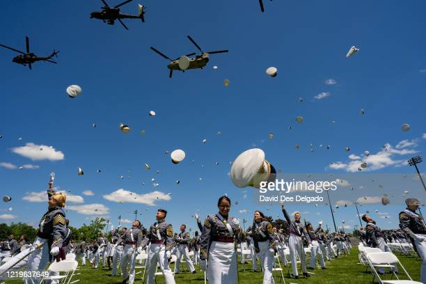 West Point graduates toss their hats in the air at the conclusion of the U.S. Military Academy Class of 2020 graduation ceremony on June 13, 2020 in...