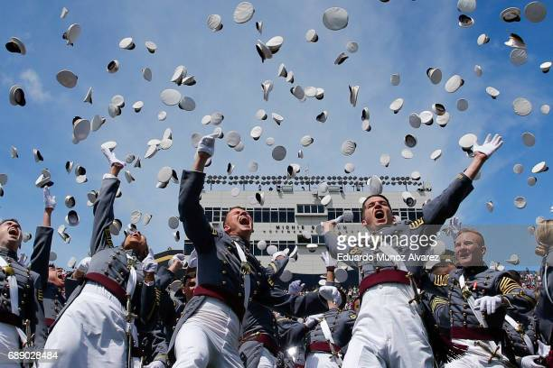 West Point graduates toss their hats in the air at the conclusion of the U.S. Military Academy Class of 2017 graduation ceremony at Michie Stadium on...