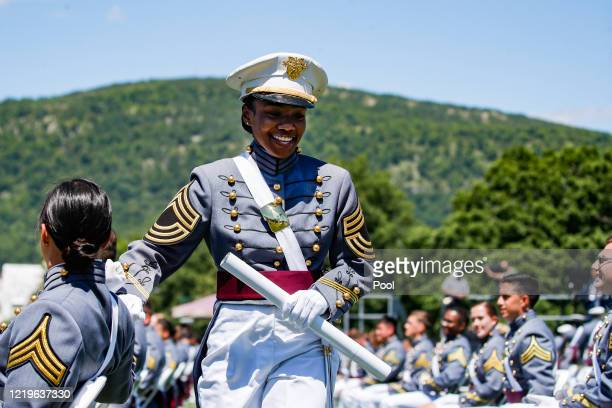 West Point graduating cadet Hadiyah Aminah Underwood celebrates with her classmates after being recognized on stage during commencement ceremonies at...