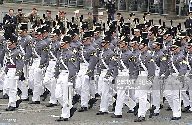 S West Point Military Academy cadets march along the Champs Elysees as they participate in the Bastile Day military parade July 14 2002 in Paris...