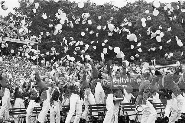 5/27/1987 West Point NY The class of 1987 at the United States Military Academy at West Point NY toss 5/27 their cadet hats to the air at the...