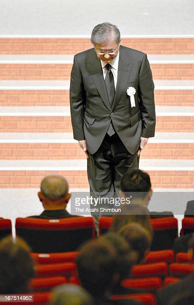 JR West President Seiji Manabe bows toward the family members and relatives of the victims during the memorial service on April 25 2013 in Amagasaki...