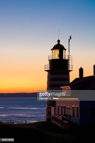 west quoddy head light at dawn. - west quoddy head lighthouse stock photos and pictures