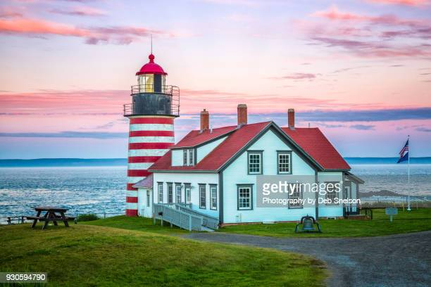 west quoddy lighthouse at sunset in lubec maine - lubec stock photos and pictures