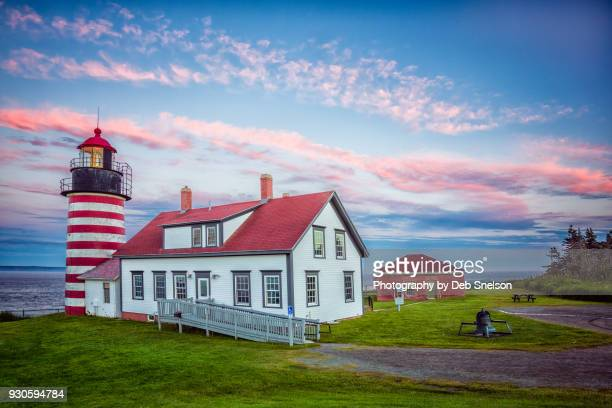 west quoddy lighthouse at twilight in lubec maine - west quoddy head lighthouse stock photos and pictures