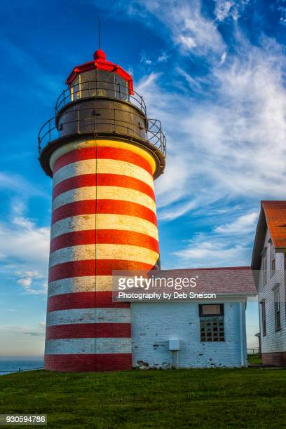 west quoddy lighthouse in lubec maine - west quoddy head lighthouse stock photos and pictures