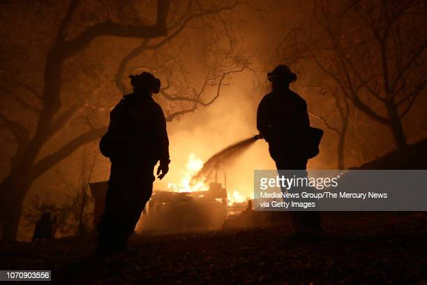 West Sacramento firefighters battle the Camp Fire on Honey Run Road in Paradise, Calif., on Friday, Nov. 9, 2018.
