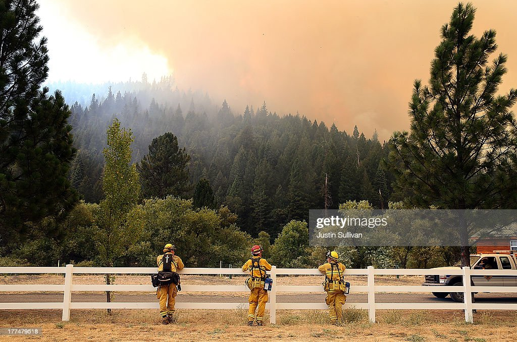 West Stanislaus County Fire firefighters monitor the Rim Fire as it approaches Yosemite Lake on August 23, 2013 near Groveland, California. The Rim Fire continues to burn out of control and threatens 4,500 homes outside of Yosemite National Park. Over 2,000 firefighters are battling the blaze that entered a section of Yosemite National Park overnight and is only 2 percent contained.