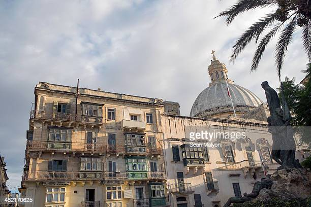 west street and dome of carmelite church, valletta, malta - sean malyon stock pictures, royalty-free photos & images
