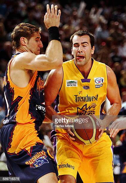 West Sydney Razorbacks' Pero Vasiljevic left and the Sydney Kings' Ian Crosswhite in action at the Sydney Superdome Homebush 28 January 2006 SHD...