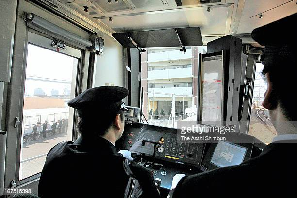 A JR West Takarazuka Line runs at the accident site on April 25 2013 in Amagasaki Hyogo Japan 107 passengers and driver were killed by train...