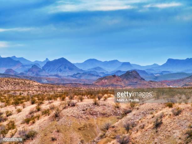 west texas landscape with mountain range in background - texas stock-fotos und bilder