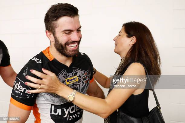 West Tigers Chairwomen Marina Go hugs James Tedesco of the Tigers following the round six NRL match between the North Queensland Cowboys and the...