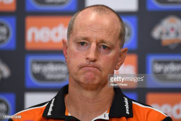 West Tigers coach Michael Maguire speaks to the media after his team's defeat during the round 25 NRL match between the Wests Tigers and the...