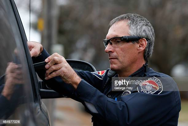 West Valley City patrol officer Gatrell performs a traffic stop on the first day of use of his newlyissued body camera attached to the side of a pair...