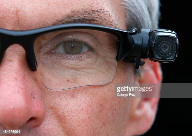 West Valley City patrol officer Gatrell shows off his newly-issued body camera attached to the side of a pair of glasses on the first day of use on...