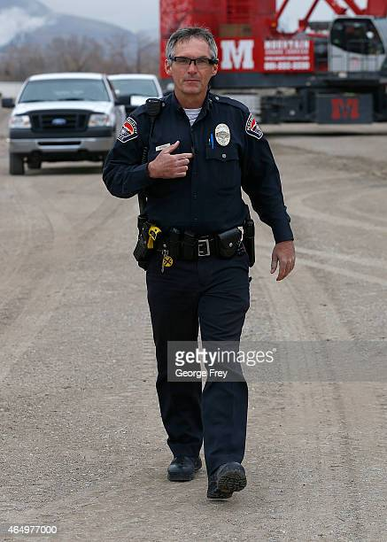 West Valley City patrol officer Gatrell stops a body camera recording by pressing a button on his chest after he took a theft report from a...