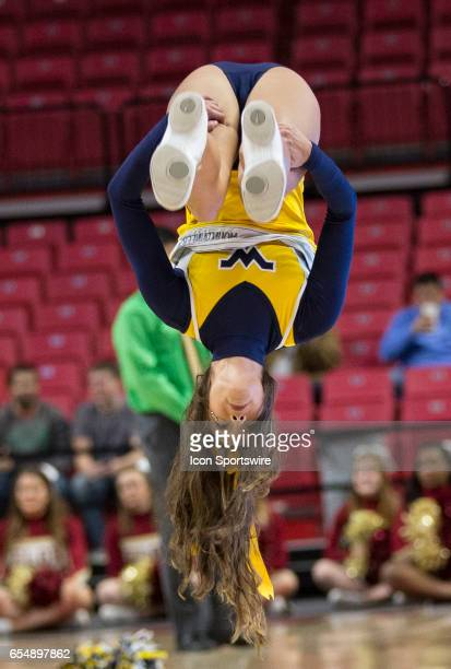 West Virginia cheerleader during a Div 1 NCAA Women's basketball 1st round game between Elon and West Virginia on March 17 at Xfinity Center in...