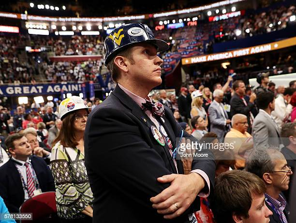 West Virginia delegate stands as he listens to Sen Ted Cruz delivering a speech on the third day of the Republican National Convention on July 20...