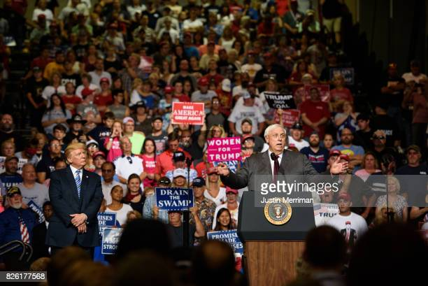 West Virginia Governor Jim Justice announces that he is switching parties to become a republican as President Donald J. Trump listens on at a...