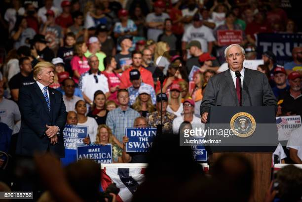 West Virginia Governor Jim Justice announces that he is switching parties to become a republican as President Donald J Trump listens on at a campaign...