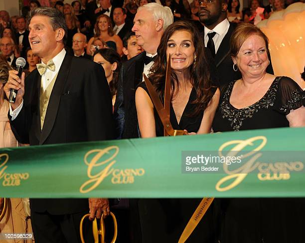 West Virginia Governor Joe Manchin owner and chairman of The Greenbrier Jim Justice Brooke Shields and Kathy Justice participate in the ribbon...