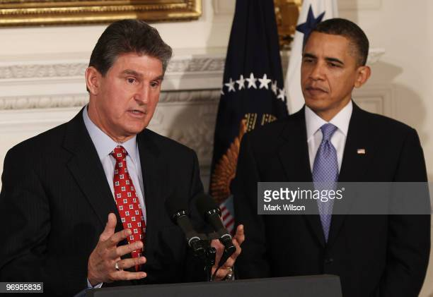 West Virginia Governor Joe Manchin speaks as U.S. President Barack Obama listens during meeting with state governors at the White House on February...