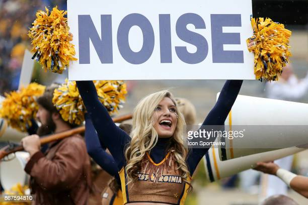 West Virginia Mountaineers cheerleader holds up a sign during the second quarter of the college football game between the Oklahoma State Cowboys and...