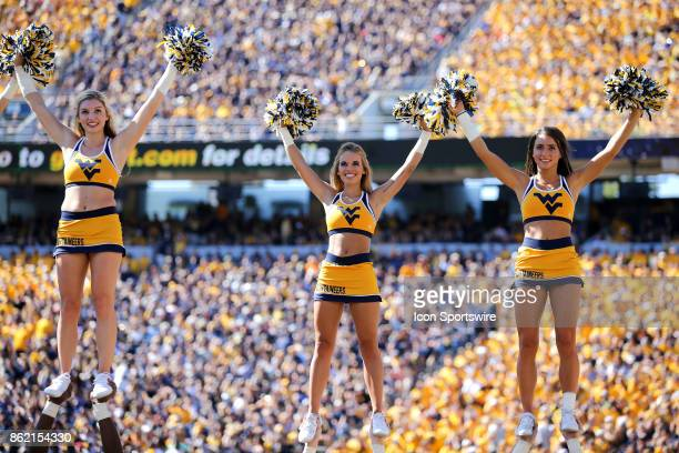 West Virginia Mountaineers cheerleaders on the field during the first quarter of the college football game between the Texas Tech Red Raiders and the...