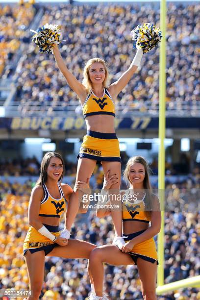 West Virginia Mountaineers cheerleaders on the field during the third quarter of the college football game between the Texas Tech Red Raiders and the...