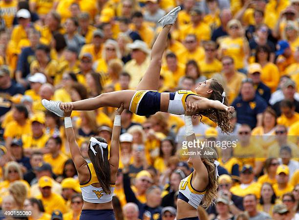 West Virginia Mountaineers cheerleaders perform during the game against the Maryland Terrapins on September 26 2015 at Mountaineer Field in...