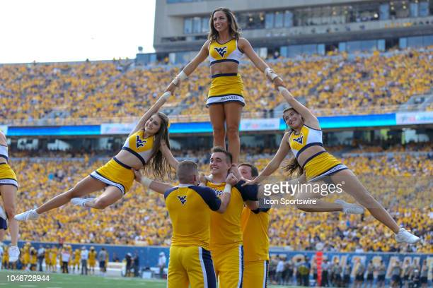 West Virginia Mountaineers cheerleaders perform during the third quarter of the college football game between the Kansas Jayhawks and the West...
