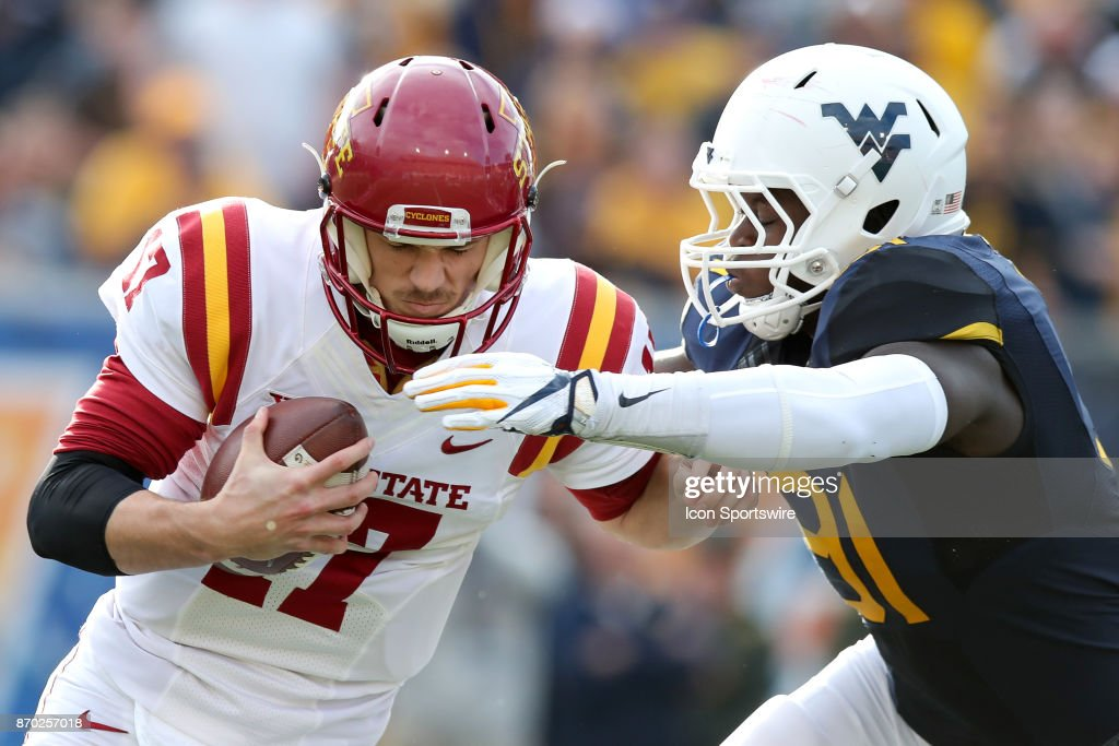 West Virginia Mountaineers defensive lineman Ezekiel Rose (91) sacks Iowa State Cyclones quarterback Kyle Kempt (17) during the first quarter of the college football game between the Iowa State Cyclones and the West Virginia Mountaineers on November 4, 2017, at Mountaineer Field at Milan Puskar Stadium in Morgantown, WV. West Virginia defeated Iowa State 20-16.