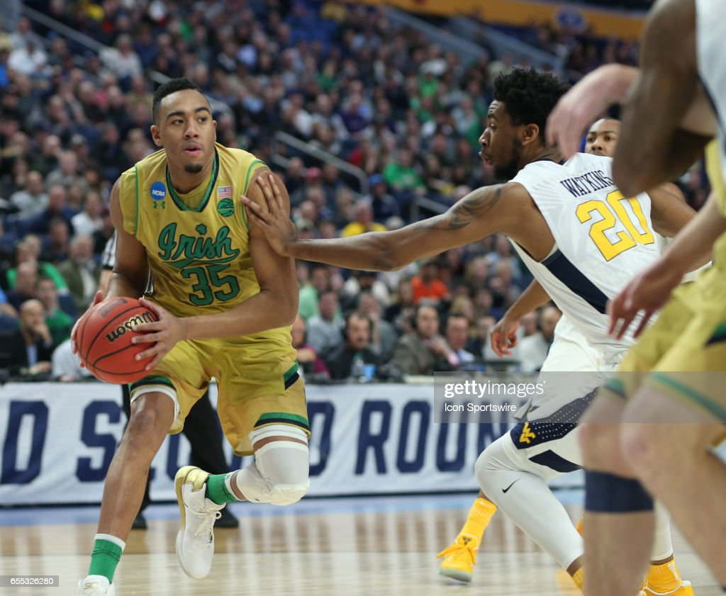 West Virginia Mountaineers forward Brandon Watkins (20) hand checks Notre Dame Fighting Irish forward Bonzie Colson (35) during the NCAA Division 1 Men's Basketball Championship game between Notre Dame Fighting Irish and West Virginia Mountaineers on March 18, 2017 at the Key Bank Center in Buffalo, NY.