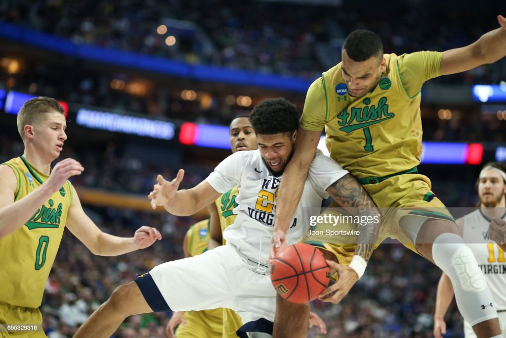 West Virginia Mountaineers forward Esa Ahmad (23) and Notre Dame Fighting Irish forward Austin Torres (1) battle for a loose ball during the NCAA Division 1 Men's Basketball Championship game between Notre Dame Fighting Irish and West Virginia Mountaineers on March 18, 2017 at the Key Bank Center in Buffalo, NY.