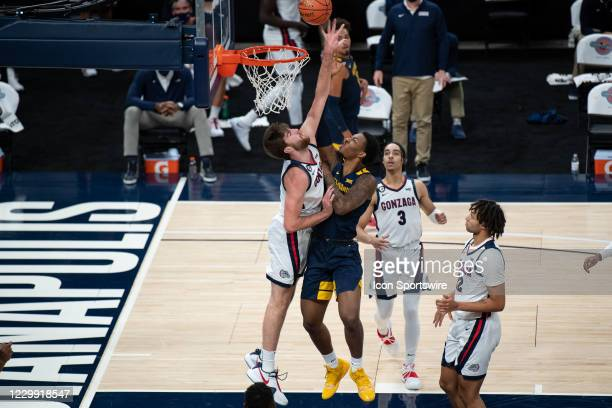 West Virginia Mountaineers forward Gabe Osabuohien drives to the basket against Gonzaga Bulldogs forward Drew Timme during the men's Jimmy V Classic...