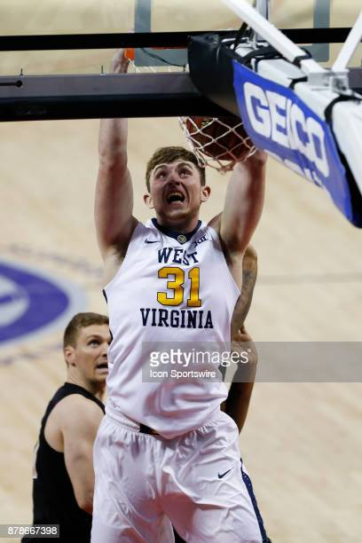 West Virginia Mountaineers forward Logan Routt dunks the ball in the 2nd half of the semi finals of the AdvoCare Invitational mens college basketball...