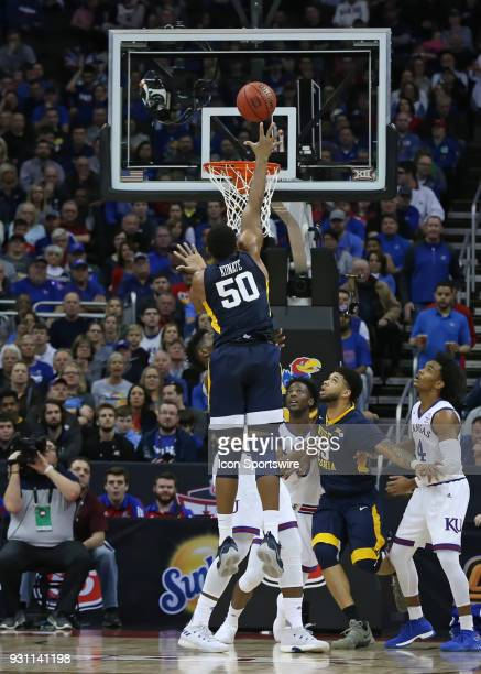 West Virginia Mountaineers forward Sagaba Konate goes up for an easy bucket in the first half of the championship game of the Big 12 Basketball...
