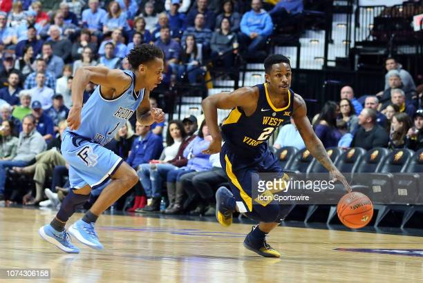 West Virginia Mountaineers guard Brandon Knapper drives past Rhode Island Rams guard Fatts Russell during a college basketball game between Rhode...