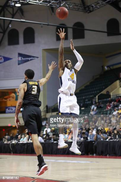 West Virginia Mountaineers guard Daxter Miles Jr takes a shot over Missouri Tigers guard Kassius Robertson in the second half of the AdvoCare...