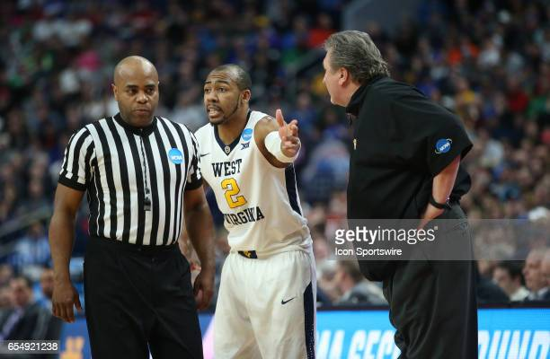 West Virginia Mountaineers guard Jevon Carter complains to the ref and West Virginia Mountaineers head coach Bob Huggins during the NCAA Division 1...