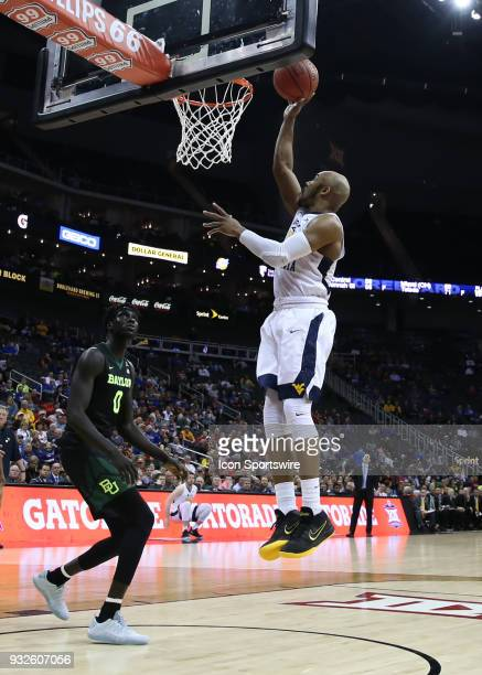 West Virginia Mountaineers guard Jevon Carter gets an easy basket in the second half of a quarterfinal game in the Big 12 Basketball Championship...