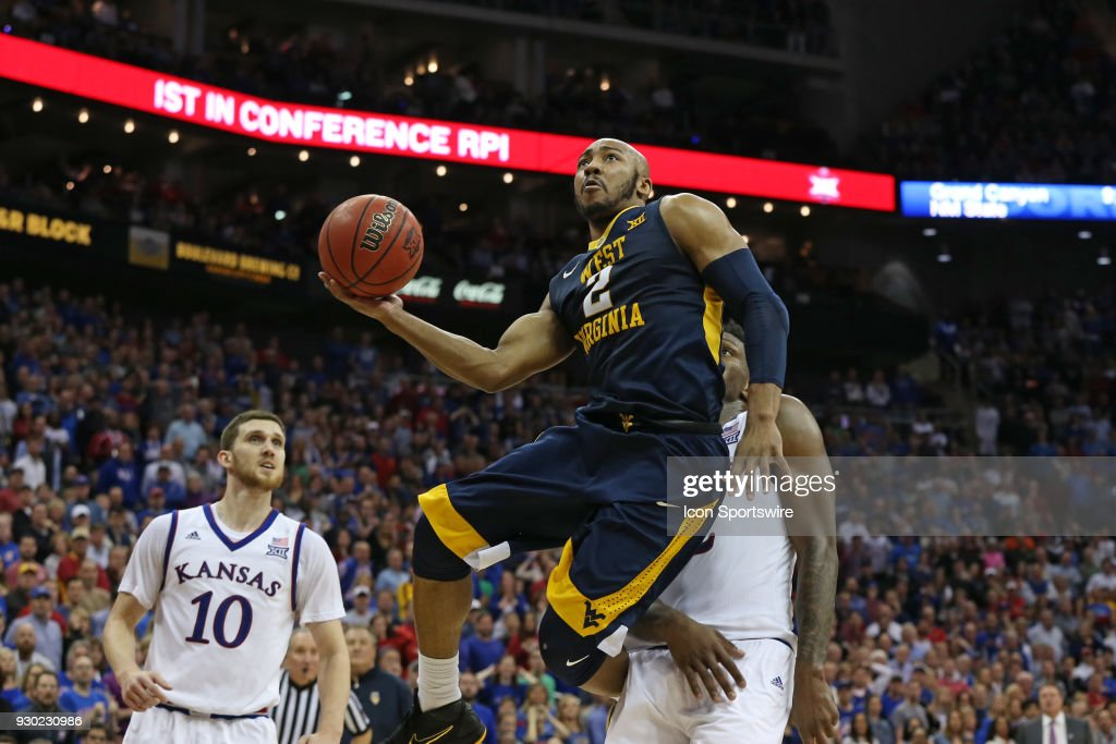 West Virginia Mountaineers guard Jevon Carter (2) goes in for a layup in the second half of the championship game of the Big 12 Basketball Championship between the West Virginia Mountaineers and Kansas Jayhawks on March 10, 2018 at Sprint Center in Kansas City, MO. Kansas won 81-70.