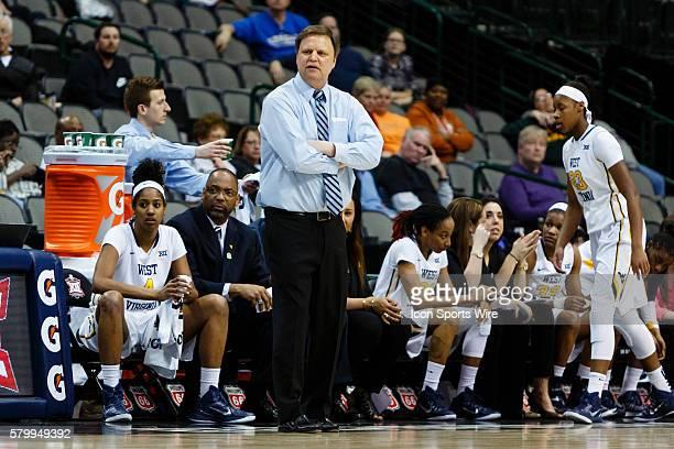 West Virginia Mountaineers head coach Mike Carey during the NCAA Big 12 Women's basketball tournament game between the West Virginia Mountaineers and...
