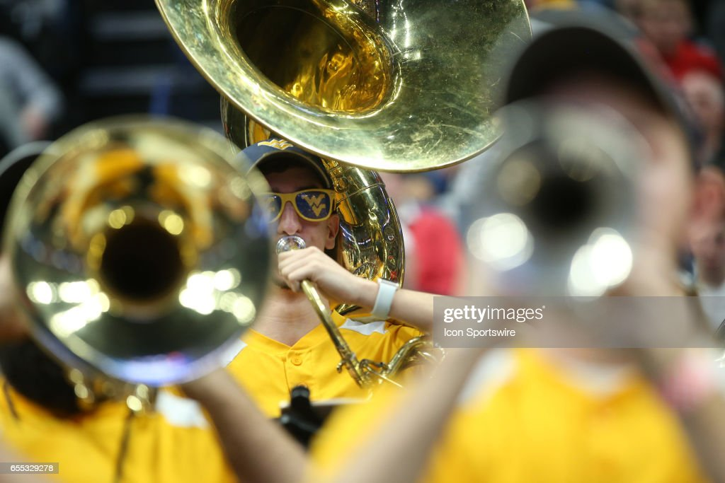 West Virginia Mountaineers marching band plays during the NCAA Division 1 Men's Basketball Championship game between Notre Dame Fighting Irish and West Virginia Mountaineers on March 18, 2017 at the Key Bank Center in Buffalo, NY.