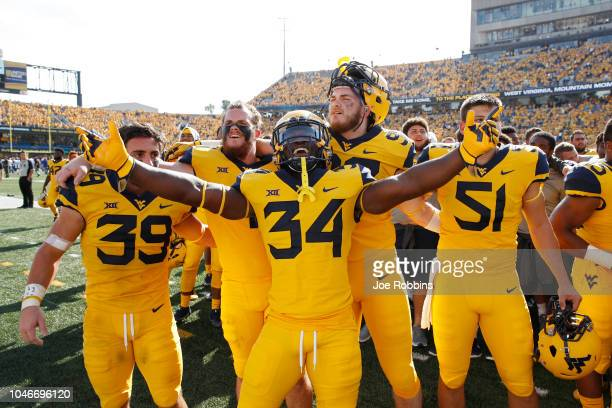 West Virginia Mountaineers players celebrate after the game against the Kansas Jayhawks at Mountaineer Field on October 6 2018 in Morgantown West...