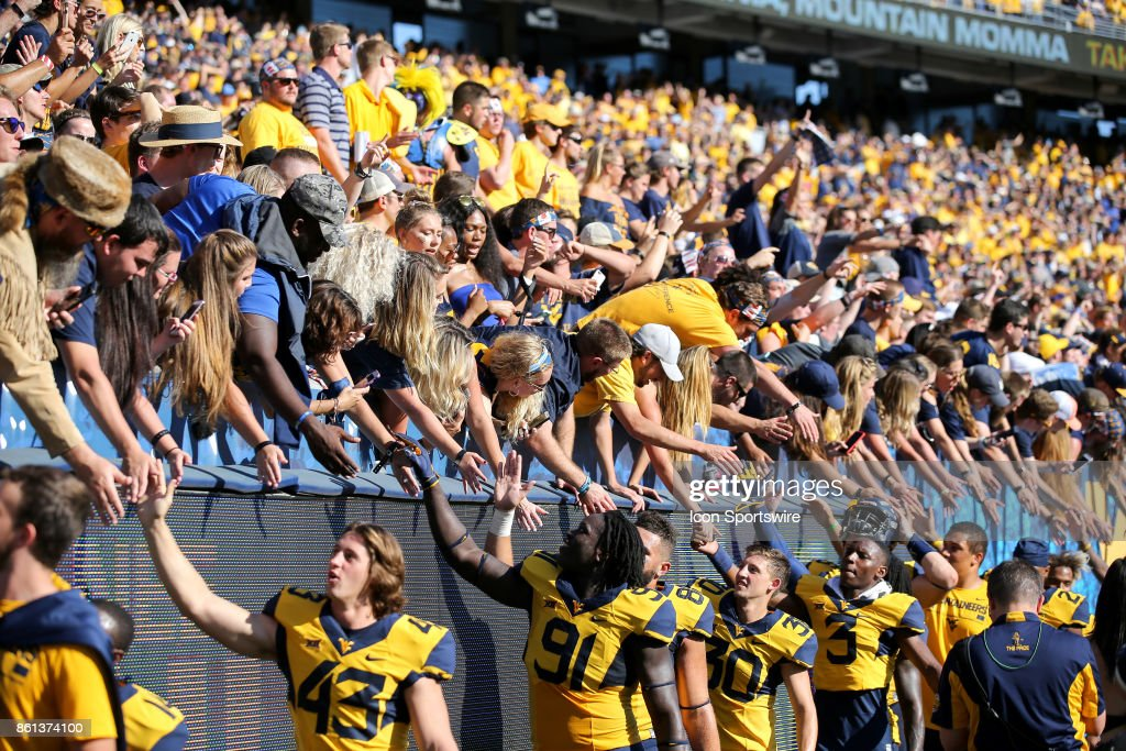 West Virginia Mountaineers Players Celebrate With The