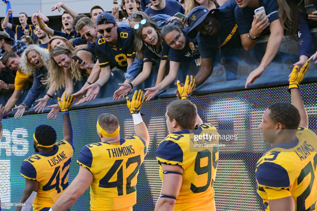West Virginia Mountaineers Players High Five The Student