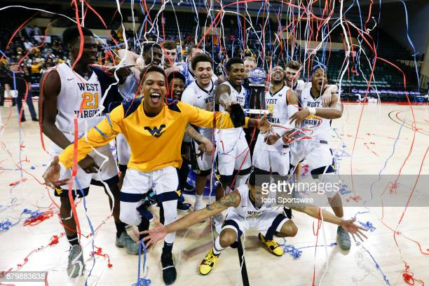 West Virginia Mountaineers pose for a photo after being crown 2017 AdvoCare Invitational champions after the mens college basketball game between the...